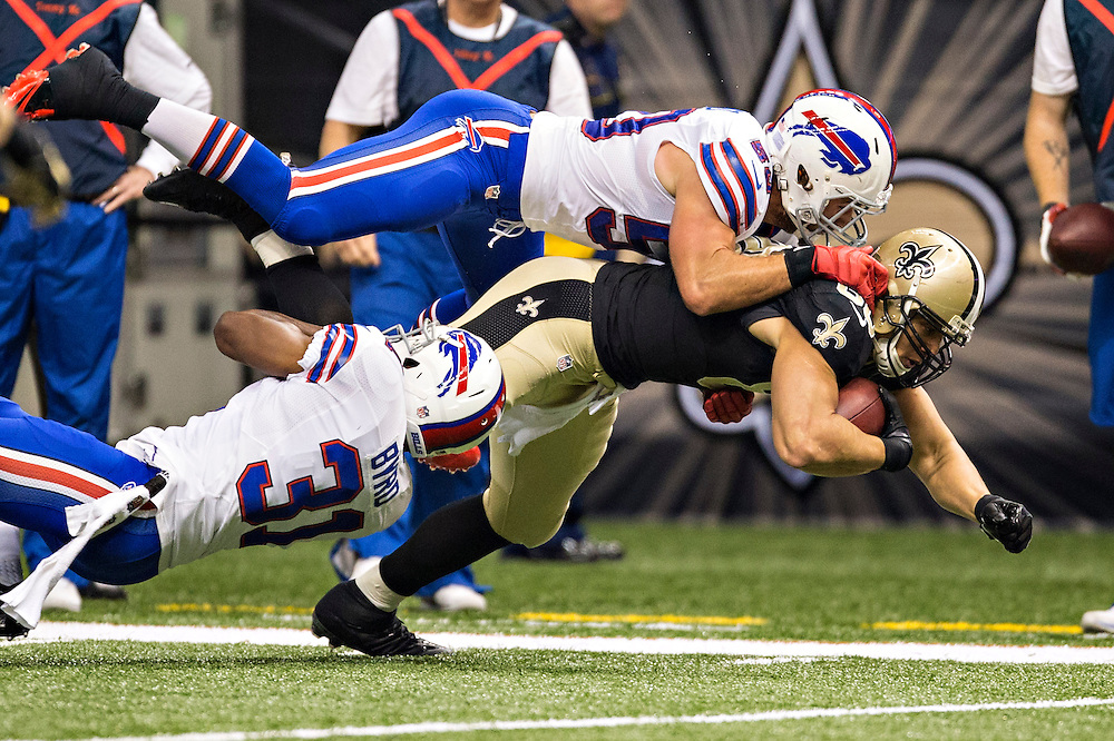 NEW ORLEANS, LA - OCTOBER 27:  Jimmy Graham #80 of the New Orleans Saints is tackled by Jairus Byrd #31 and Kiko Alonso #50 of the Buffalo Bills at Mercedes-Benz Superdome on October 27, 2013 in New Orleans, Louisiana.  The Saints defeated the Bills 35-14.  (Photo by Wesley Hitt/Getty Images) *** Local Caption *** Jimmy Graham, Jairus Byrd; Kiko Alonso