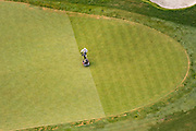 A landscaper mows a putting green at the Ventanas de San Miguel golf course outside the colonial city of San Miguel de Allende, Mexico.