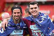 Burnley midfielder, George Boyd (21) and Burnley defender, Michael Keane (05) celebrating winning league during the Sky Bet Championship match between Charlton Athletic and Burnley at The Valley, London, England on 7 May 2016. Photo by Matthew Redman.