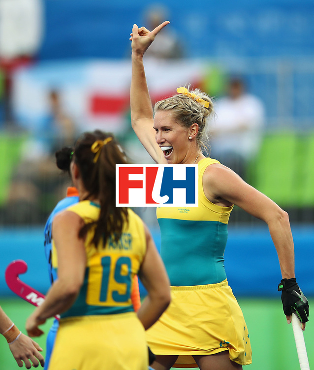 RIO DE JANEIRO, BRAZIL - AUGUST 10:  Jodie Kenny of Australia (R) celebrates a goal during the Women's Pool B Match between India and Australia on Day 5 of the Rio 2016 Olympic Games at the Olympic Hockey Centre on August 10, 2016 in Rio de Janeiro, Brazil.  (Photo by Mark Kolbe/Getty Images)