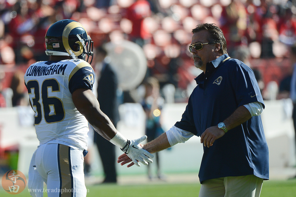 December 1, 2013; San Francisco, CA, USA; St. Louis Rams head coach Jeff Fisher (right) high-fives running back Benny Cunningham (36) against the San Francisco 49ers before the game at Candlestick Park.