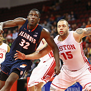 Dom Morris #15 of the Boston University Terriers and Nnanna Egwu #32 of the Illinois Fighting Illini fight for a rebound during the NIT First Round game at Agganis Arena on March 19, 2014 in Boston, Massachusetts . (Photo by Elan Kawesch)