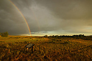 Double rainbow over Buffalo Camp and interpretive sign at American Prairie Reserve in the Great Plains of Montana. South of Malta in Phillips County, Montana.