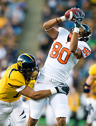November 7, 2009; Berkeley, CA, USA;  Oregon State Beavers wide receiver Damola Adeniji (80) makes a catch California Golden Bears cornerback Sean Cattouse (11) in front of during the first quarter at Memorial Stadium.