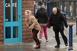 © Licensed to London News Pictures. 09/02/2020. Porthcawl, Bridgend, Wales, UK. People struggle in severe gale force winds in the Welsh seaside resort of Porthcawl in Bridgend, UK. Photo credit: Graham M. Lawrence/LNP