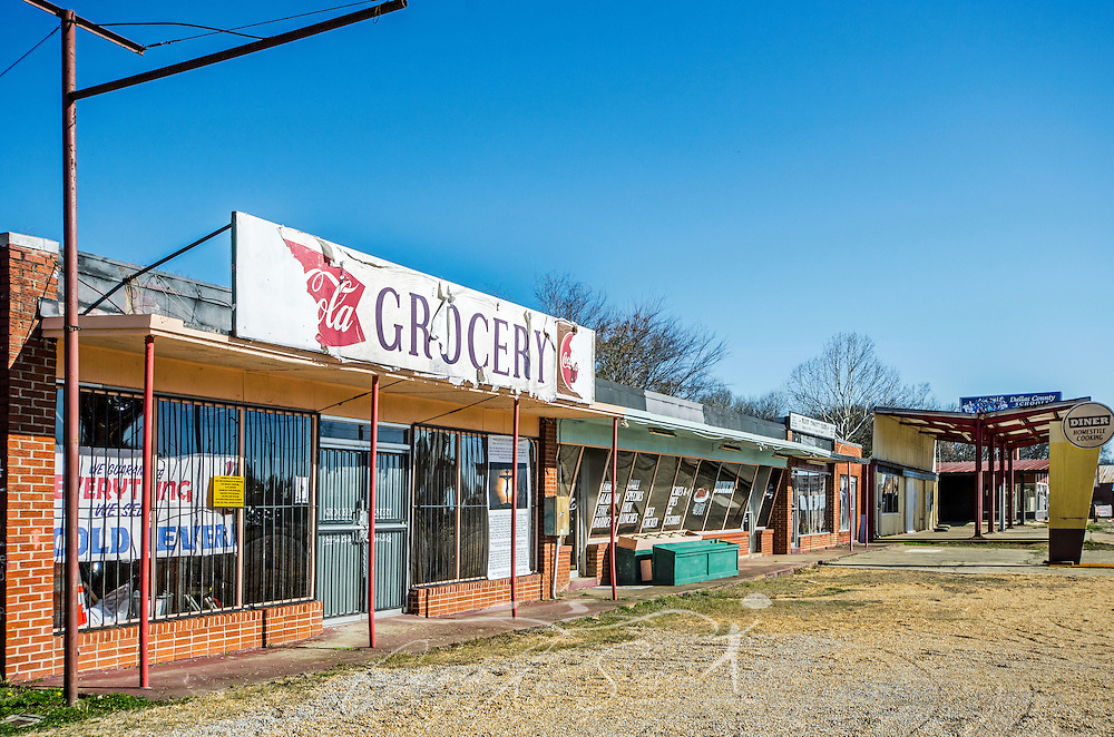 An abandoned strip mall sits beside Civil Rights Memorial Park, Feb. 7, 2015, in Selma, Alabama. The park was established in 2001 and includes murals and plaques honoring those who led the Civil Rights movement in Selma in the 1960's. (Photo by Carmen K. Sisson/Cloudybright)
