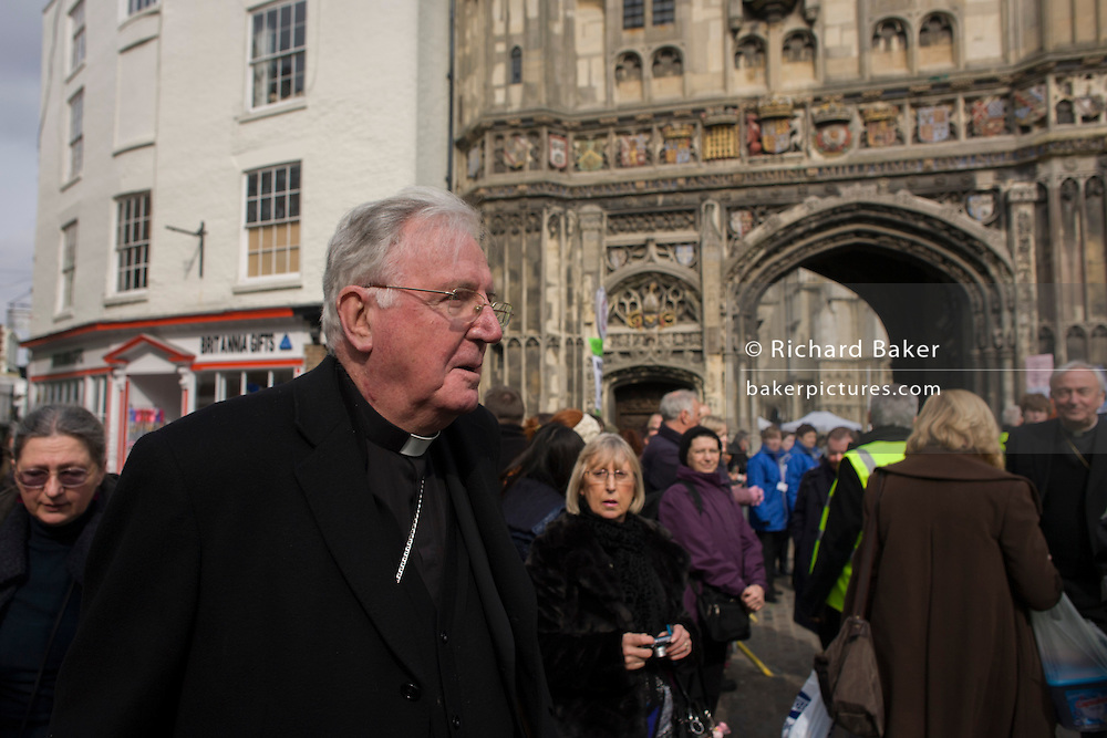 Canterbury 21/3/2013 - Cardinal Cormac Murphy O'Connor, head of the Catholic church in the UK walks towards Church Gate as VIP guests from all religions, denominations and faiths arrive before the enthronement of the Church of England's 105th Archbishop of Canterbury, ex-oil executive and former Bishop of Durham the Right Reverend Justin Welby. Welby (57) follows a long Anglican heritage since Benedictine monk Augustine, the first Archbishop of Canterbury in 597AD Prince Charles and Prime Minister David Cameron joined 2,000 VIP guests to Canterbury Cathedral, the oldest church in England which has attracted pilgrims since Thomas a Becket was murdered in the Cathedral in 1170.