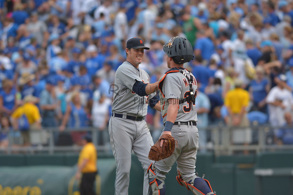 Sep 20, 2014; Kansas City, MO, USA; Detroit Tigers relief pitcher Joe Nathan (36) is congratulated by catcher James McCann (34) after the game against the Kansas City Royals at Kauffman Stadium. Detroit won 3-2. Mandatory Credit: Denny Medley-USA TODAY Sports