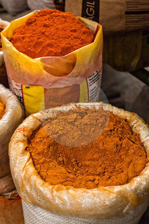 Ground chili peppers powder at Benito Juarez market in Oaxaca, Mexico.