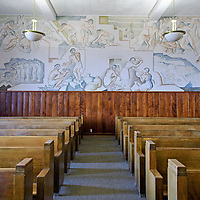 """Lloyd Moylan's 10-foot murals depicting the """"History of the Gallup Region"""" in a courtroom on the second floor of the McKinley County Courthouse."""