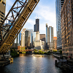 Photo of Chicago downtown and Kinzie Street Railroad Bridge along the Chicago River with Willis Tower (Sears Tower) and other buildings. Kinzie Street Railroad Bridge is a Chicago landmark that is permanently raised and no longer used. Picture is vertical and high resolution.