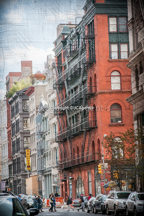 Colorful street scene on Broome Street with focus on the old SoHo architecture by Jacqueline C Agentis. Limited Edition 1 of 50