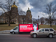 09 JANUARY 2020 - DES MOINES, IOWA: A mobile digital billboard calling for Pres. Donald Trump's impeachment parked the Iowa State Capitol in Des Moines. The mobile billboards are organized by four organizations: Daily Kos, MoveOn, Need to Impeach, and Public Citizen. They are targeting eight Republican Senators: Lisa Murkowski (Alaska), Martha McSally (Ariz.), Cory Gardner (Colo.), Joni Ernst (Iowa), Mitch McConnell (Ky.), Susan Collins (Maine), Thom Tillis (N.C.), and Mitt Romney (Utah).        PHOTO BY JACK KURTZ