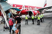 JAKARTA; THURSDAY, OCTOBER 9, 2014; INDONESIA ECONOMIC RISING:  Passengers wait in line for boarding on a commercial place at Soekarno-Hatta International Airport in Tangerang, Banten, Indonesia on Thursday, October 9, 2014. The traveling via airplane has increased as the rise of annual income per capita. According to Asian Development Bank's 2014 report, Indonesia economy growth potential is in creative industry after for years relies heavily on natural resources such as mineral mining and palm oil. By the presidency of Joko Widodo, as a product of the third people election after the People Power Revolution in 1998, Indonesia is more confident in the economy growth and optimistic to become equal in quality to Brazil and China's economy growth. The emerging of Indonesia economy for the last one and a half decade after the end of Suharto's Dictatorship has been in significant way, the per capita growth has reached 400% under Susilo Bambang Yudhoyono presidency. Indonesia is home for 74 million of middle class as estimated by Boston Consulting Group, and  will double in 2020.
