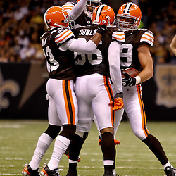 Oct 24, 2010; New Orleans, LA, USA; Cleveland Browns linebacker Scott Fujita (99) celebrates with teammates following an interception against the New Orleans Saints during the first half at the Louisiana Superdome. Mandatory Credit: Derick E. Hingle