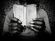 The hands of a homeless man, holding a bible as he reads it on the streets of Knoxville, Tennessee. Poverty and homelessness continues to be a problem in Tennessee especially for Tennessee children.