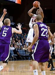 Virginia guard Sean Singletary (44) shoots a jumper over Northwestern guard-forward Jeff Ryan (5).  The Virginia Cavaliers men's basketball team faced the Northwestern Wildcats at John Paul Jones Arena in Charlottesville, VA on November 27, 2007.