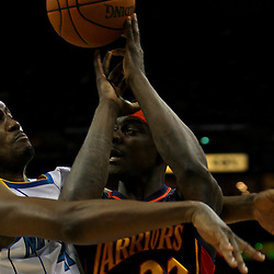 Dec 23, 2009; New Orleans, LA, USA; Golden State Warriors guard Anthony Morrow (22) loses the ball as he collides with New Orleans Hornets forward James Posey (41) during the fourth quarter at the New Orleans Arena. The Hornets defeated the Warriors 108-102. Mandatory Credit: Derick E. Hingle-US PRESSWIRE
