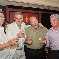Chief Irish Whiskey Ambassdor and Founder of Kilbeggan Kleran Folliard, Master Ambassador Canadian Whiskey Dan Tullio of Canadian Club, 7th Generation Beam Master Distiller and Jim Beam's Great Grandson Fred Noe of Beam and Master Ambassador Scotch Whiskey Simon Brooking of Laphroaig toasting at The Great Whisk[E]y Debate on Thursday July 18, 2013 at the Bourbon House Restaurant on Bourbon Street in New Orleans. ©2013, Gustavo Escanelle, All Rights Reserved.