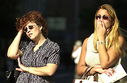 Maria Hernandez and Irma Meneve react as they watch the  World Trade Towers burn on 09/11/01. They have family who work in the towers.