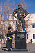 Paying homage to wrestler statue<br /> Dalanzadgad Town<br /> Gobi Desert<br /> Mongolia