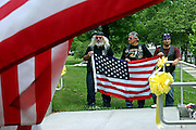 Members of the Patriot Guard Riders holding a US flag during the funeral service of Sgt. Ian T. Sanchez, in Staten Island, NY., on Tuesday, June 27, 2006. Sgt. Sanchez, a 26-year-old American serviceman was killed by a roadside bomb in the Pech River Valley, Afghanistan. The Patriot Guard Riders is a diverse amalgamation of riders from across the United States of America. Besides a passion for motorcycling, they all have in common an unwavering respect for those who risk their lives for the country's freedom and security. They are an American patriotic group, mainly but not only, composed by veterans from all over the United States. They work in unison, calling upon tens of different motorcycle groups, connected by an internet-based web where each of them can find out where and when a 'Mission' is called upon, and have the chance to take part. This way, the Patriot Guard Riders can cover the whole of the United States without having to ride from town to town but, by organising into different State Groups, each with its own State Captain, they are still able to maintain strictly firm guidelines, and to honour the same basic principles that moves the group from the its inception. The main aim of the Patriot Guard Riders is to attend the funeral services of fallen American servicemen, defined as 'Heroes' by the group,  as invited guests of the family. These so-called 'Missions' they undertake have two basic objectives in particular: to show their sincere respect for the US 'Fallen Heroes', their families, and their communities, and to shield the mourners from interruptions created by any group of protestors. Additionally the Patriot Guard Riders provide support to the veteran community and their families, in collaboration with the other veteran service organizations already working in the field.   **ITALY OUT**