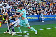 Queens Park Rangers forward Ryan Manning (14) pushes Millwall midfielder Ben Thompson (8) so that the ball goes out of play during the EFL Sky Bet Championship match between Millwall and Queens Park Rangers at The Den, London, England on 21 September 2019.