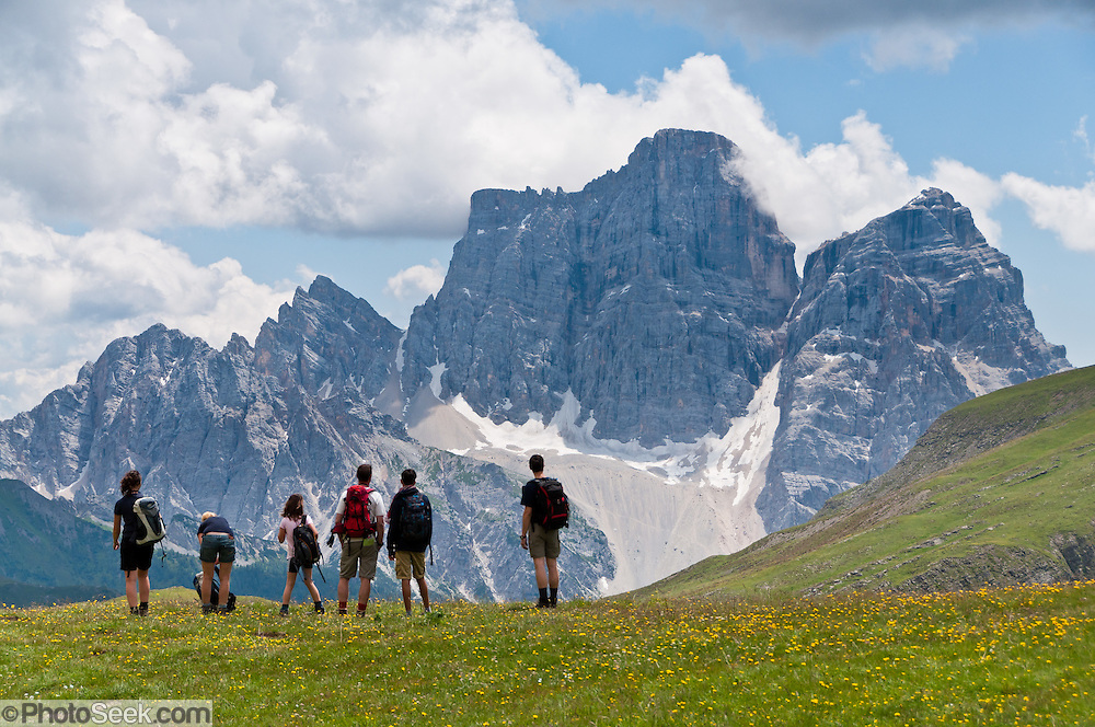 A hiking family admires Monte Civetta from a trail near Gasthaus Passo di Giau, in Dolomites (Dolomiti, a part of the Southern Limestone Alps), northern Italy, Europe. The Dolomites were declared a natural World Heritage Site (2009) by UNESCO.