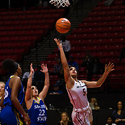 24 February 2018: The San Diego State women's basketball team closes out it's home schedule of the regular season Saturday afternoon against San Jose State. San Diego State Aztecs guard Te'a Adams (5) attempts a shot under the basket during the first half. The Aztecs beat the Spartans 85-78 at Viejas Arena.<br /> More game action at sdsuaztecphotos.com