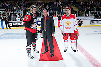 KELOWNA, CANADA - NOVEMBER 9: Collin Shirley #24 of Team WHL and Artur Lauta #23 of Team Russia accept the players of the game award against the Team Russia on November 9, 2015 during game 1 of the Canada Russia Super Series at Prospera Place in Kelowna, British Columbia, Canada.  (Photo by Marissa Baecker/Western Hockey League)  *** Local Caption *** Collin Shirley; Artur Lauta;