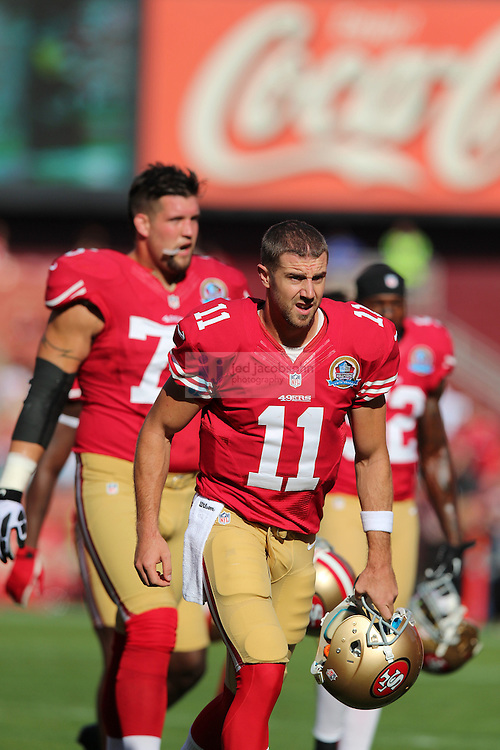 San Francisco 49ers quarterback Alex Smith (11) looks on against the Miami Dolphins during an NFL game at Candlestick Park on December 9, 2012 in San Francisco, CA.  (Photo by Jed Jacobsohn)