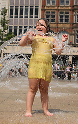 © Licensed to London News Pictures . 17/07/2013 . Nottingham, UK .Three-year-old Vanessa Mesiarova, of Beeston, has some fun at the water spring in Market Square House, Nottingham, as the heatwave continues across the UK with temperatures soaring to 30 degrees Celsius. Photo credit : /LNP