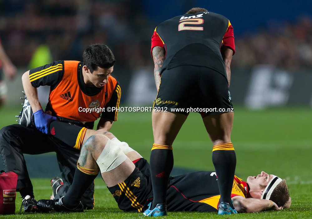 Chiefs' captain Craig Clarke gets attention from a physio as Mahonri Schwalger looks on during the Super Rugby Semi Final won by the Chiefs (20-17) against the Crusaders at Waikato Stadium, Hamilton, New Zealand, Friday 27 July 2012. Photo: Stephen Barker/Photosport.co.nz