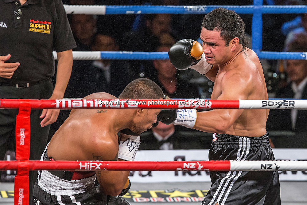 Vaitele SoI (L) fights Lance `Buster` Bryant  in the Mahindra Super 8 Fight Night, North Shore Events Centre, Auckland, New Zealand, Saturday, November 22, 2014. Photo: David Rowland/Photosport