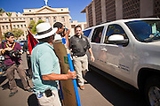 17 OCTOBER 2011 - PHOENIX, AZ:  MICHELE BACHMANN, a Republican candidate for US President, (in the open window of the car) leaves the Arizona state capitol after talking to members of the Arizona legislators at the State Capitol in Phoenix. Bachmann met with Republican Arizona legislators and Republican members of the state's Congressional delegation Monday morning to talk about illegal immigration and border security. During the meeting she pledged that if she were elected US President, she would construct a fence along the US - Mexico border.  PHOTO BY JACK KURTZ