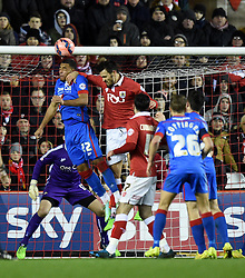 Bristol City's Marlon Pack and Doncaster' Reece Wabara compete for the ball close to the Doncaster net during the FA Cup third round replay between Bristol City and Doncaster Rovers at Ashton Gate on January 13, 2015 in Bristol, England. - Photo mandatory by-line: Paul Knight/JMP - Mobile: 07966 386802 - 13/01/2015 - SPORT - Football - Bristol - Ashton Gate Stadium - Bristol City v Doncaster Rovers - FA Cup third round replay