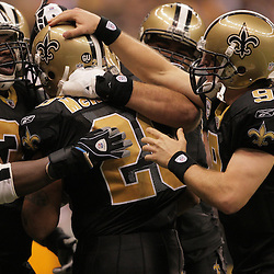 2008 November, 24: Teammates swarm New Orleans Saints running back Deuce McAllister (26) after he scored a touchdown during 51-29 victory by the New Orleans Saints over the Green Bay Packers on Monday Night Football at the Louisiana Superdome in New Orleans, LA.