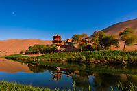 Crescent Lake (Yueyaquan) is a crescent-shaped lake in an oasis, 6 km south of the city of Dunhuang in Gansu Province, China