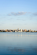 The morning sun shines on Lake Monona and the downtown Madison, Wis., skyline as fishing boats dot the water during a summer sunrise on Aug. 4, 2015. On the horizon at center are the Wisconsin State Capitol and Monona Terrace Community and Convention Center. (Photo by Jeff Miller - www.jeffmillerphotography.com)