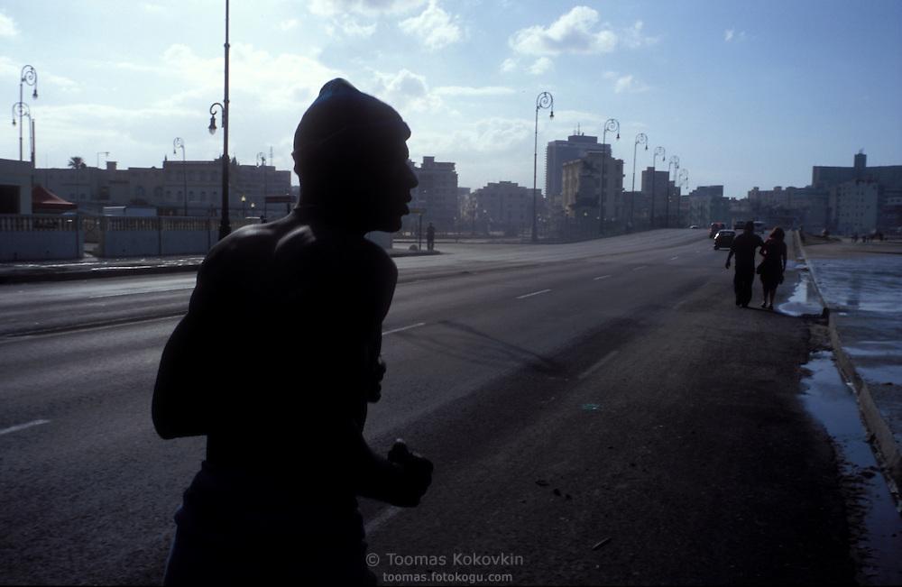 Morning jogger on Malecon, coastal street in Habana, Cuba.