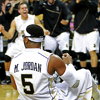 Players react to a foul call as Marcus Jordan (5) of the University of Central Florida Knights mens basketball team plays against the West Florida Argonauts in the first home game of the 2010 season at the UCF Arena on November 12, 2010 in Orlando, Florida. UCF won the game 115-61. (AP Photo/Alex Menendez)