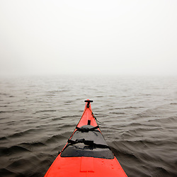 A kayak in the fog on Long Pond in Maine's Acadia National Park.