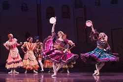 © Licensed to London News Pictures. 18/09/2015. London, UK. Les Ballets Trockadero de Monte Carlo (The Trocks) perform the UK premiere of Don Quixote during a photocall at the Peacock Theatre. With Yakaterina Verbosovich (Chase Johnsey) as Kitri, Vyacheslav Legupski (Paolo Cervellera) as Basil, Olga Supphozova (Robert Carter) as Amour, Lariska Dumbcheno (Raffaele Morra) as Mother, Boris Nowitsky (Carlos Renedo) as Count and Varvara Bractchikova (Giovanni Goffredo) and Eugenia Repelskii (Joshua Thake) as Gypsies. Photo credit: Bettina Strenske/LNP