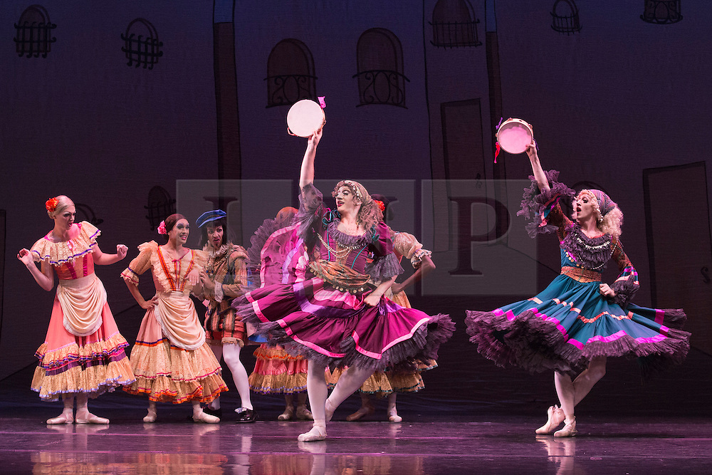 © Licensed to London News Pictures. 18/09/2015. London, UK. Les Ballets Trockadero de Monte Carlo (The Trocks) perform the UK premiere of Don Quixote during a photocall at the Peacock Theatre. With Yakaterina Verbosovich (Chase Johnsey) as Kitri, Vyacheslav Legupski (Paolo Cervellera) as Basil, Olga Supphozova (Robert Carter) as Amour, Lariska Dumbcheno (Raffaele Morra) as Mother, Boris Nowitsky (Carlos Renedo) as Count and Varvara Bractchikova (Giovanni Goffredo) and Eugenia Repelskii (Joshua Thake) as Gypsies. Photo credit: Bettina Strenske/LNP