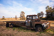 Auto truck among abandoned rusty old American automobiles in MIssissippi, USA