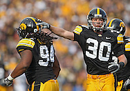 October 23 2010: Iowa Hawkeyes defensive end Adrian Clayborn (94) is congratulated by Iowa Hawkeyes cornerback Brett Greenwood (30) after causing a fumble during the first half of the NCAA football game between the Wisconsin Badgers and the Iowa Hawkeyes at Kinnick Stadium in Iowa City, Iowa on Saturday October 23, 2010. Wisconsin defeated Iowa 31-30.