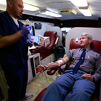 "Thomas Wells | BUY at PHOTOS.DJOURNAL.COM<br /> United Blood Services employee Jonathan Fortner, left, takes care of Mississippi High Patrol Lt. John Hillhouse as he donates blood on Wednesday at the Troop ""F"" headquarters in New Albany."