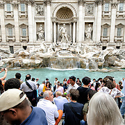 Tourists crowd around the Fontana di Trevi (Trevi Fountain) in Rome, Italy.