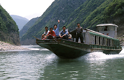 CHINA SICHUAN PROVINCE THREE LITTLE GORGES MAY99 - A boat carrying tourists speeds up a stream at the Three Little Gorges, a famous landmark of China's Sichuan province. Seven large cities, including Chongquing, and thousands of villages will be submerged once the water level rises after the completion of the controversial Three Gorges Dam project further downriver. The flooding of areas reaching back more than 550Km upriver will require the evacuation and resettlement of more than 10 million people.  jre/Photo by Jiri Rezac. © Jiri Rezac 1999. . Contact: +44 (0) 7050 110 417. Mobile:  +44 (0) 7801 337 683. Office:  +44 (0) 20 8968 9635. . Email:   jiri@jirirezac.com. Web:     www.jirirezac.com