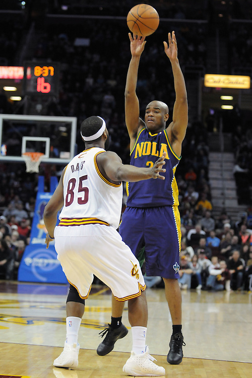 March 6, 2011; Cleveland, OH, USA; New Orleans Hornets point guard Jarrett Jack (2) passes over Cleveland Cavaliers point guard Baron Davis (85) during the third quarter at Quicken Loans Arena. The Hornets beat the Cavaliers 96-81. Mandatory Credit: Jason Miller-US PRESSWIRE